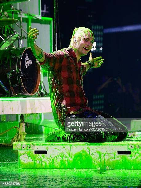 Musician Michael Clifford of 5 Seconds of Summer performs at the Nickelodeon's 28th Annual Kids' Choice Awards at The Forum on March 28 2015 in...