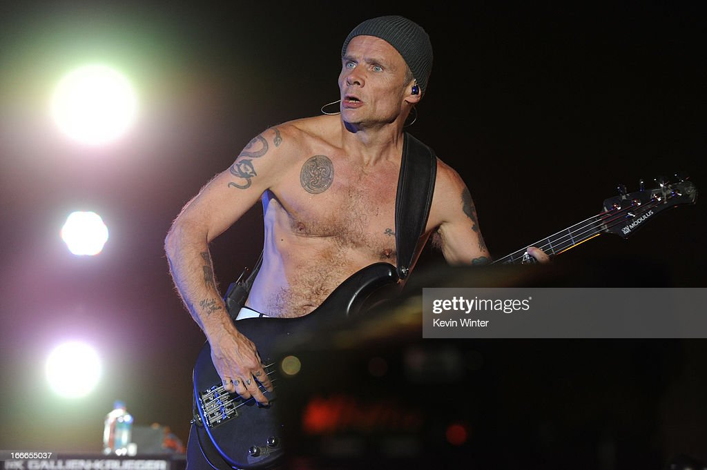 Musician Michael 'Flea' Balzary of the band Red Hot Chili Peppers performs onstage during day 3 of the 2013 Coachella Valley Music Arts Festival at...