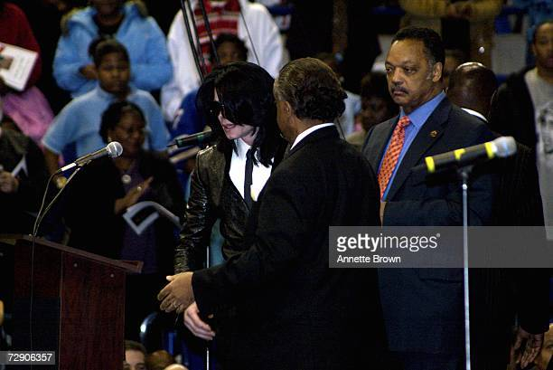 Musician Michael Jackson Reverend Al Sharpton and the Reverend Jesse Jackson approach the podium during a homegoing celebration for musician James...
