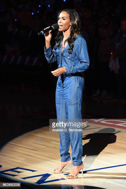 Musician Michelle Williams sings the National Anthem before the Houston Rockets game against the Golden State Warriors on October 17 2017 at ORACLE...