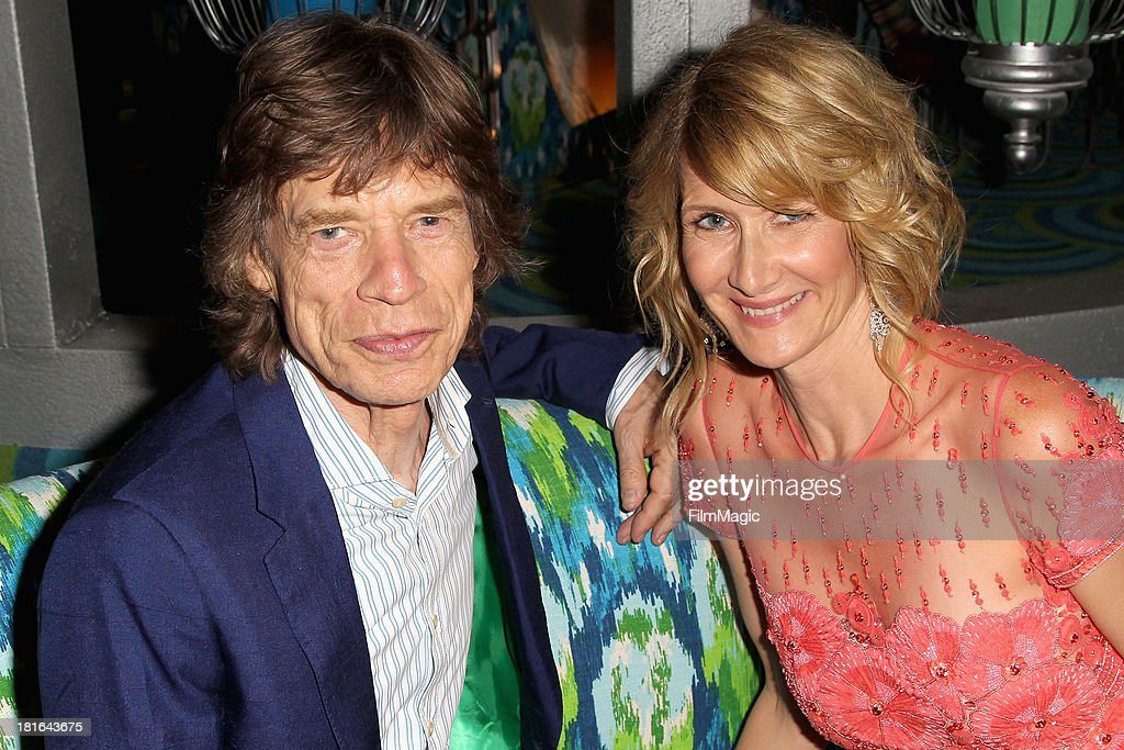 Musician Mick Jagger and actress Laura Dern attend HBO's official Emmy after party at The Plaza at the Pacific Design Center on September 22, 2013 in Los Angeles, California.