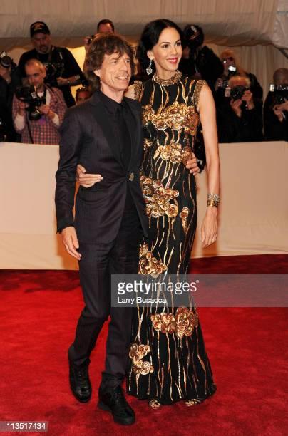 Musician Mick Jagger and Designer L'Wren Scott attend the 'Alexander McQueen Savage Beauty' Costume Institute Gala at The Metropolitan Museum of Art...