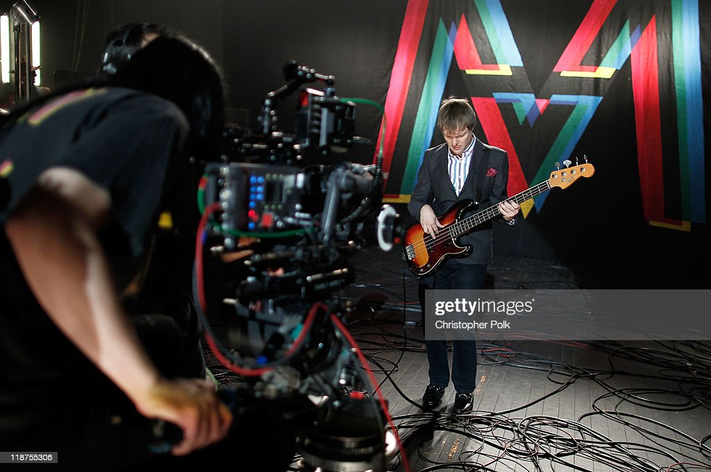 Musician Mickey Madden of the band Maroon 5 performs at the Maroon 5 Video Shoot for 'Moves Like Jagger' with Christina Aguilera on July 8, 2011 in Los Angeles, California.