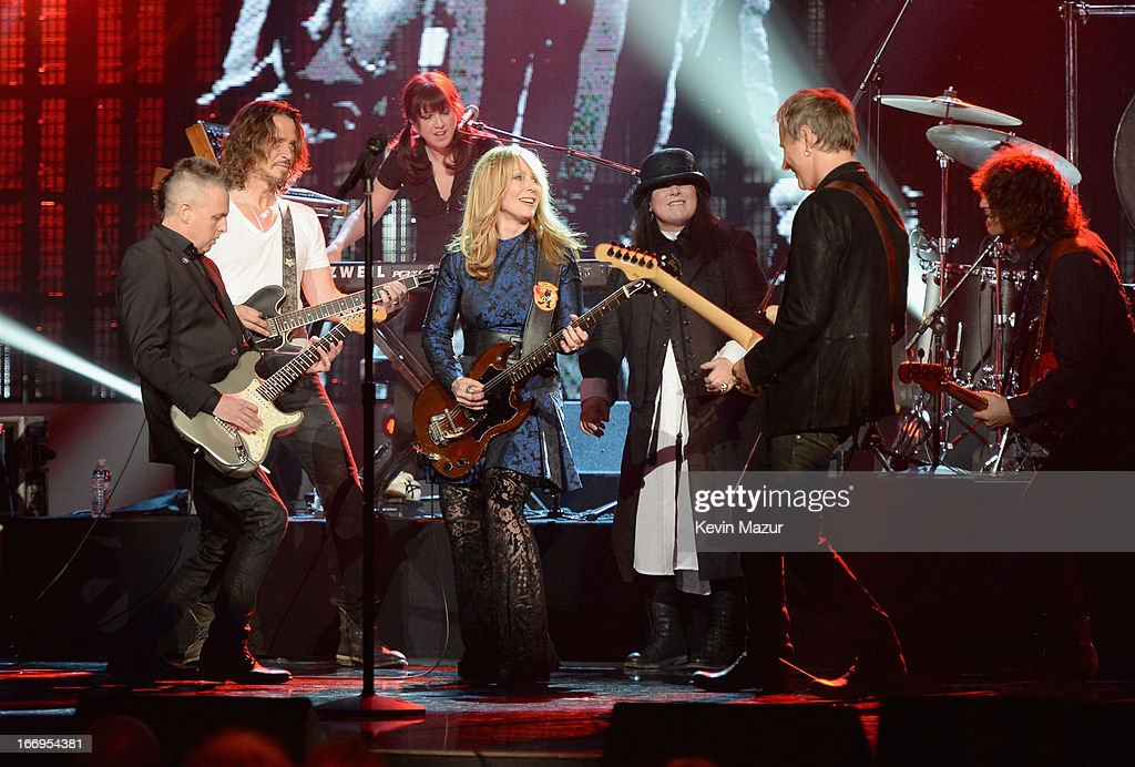 Musician Mike McCready musician Chris Cornell keyboardist Debby Shair inductee Nancy Wilson inducteee Ann Wilson and musician Jerry Cantreell perform...