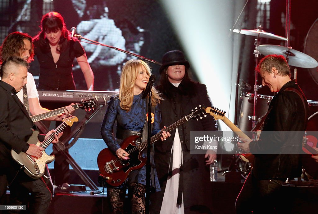 Musician Mike McCready of Pearl Jam inductees Nancy Wilson and Ann Wilson of Heart and musician Jerry Cantrell of Alice in Chains perform onstage...