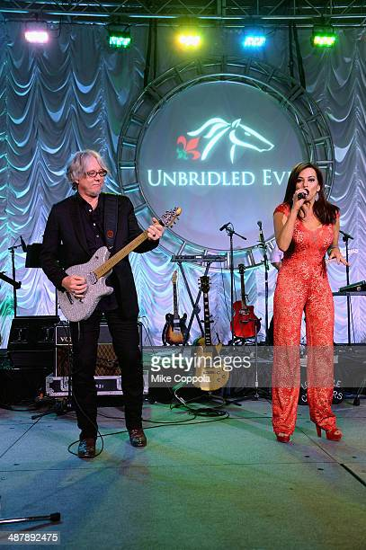 Musician Mike Mills and Robin Meade perform at the 2014 Unbridled Eve Derby Gala during the 140th Kentucky Derby at Galt House Hotel Suites on May 2...
