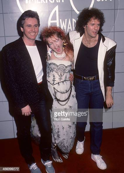Musician Mike Reno of Loverboy singer Cyndi Lauper and musician Paul Dean of Loverboy attend the 11th Annual American Music Awards on January 16 1984...