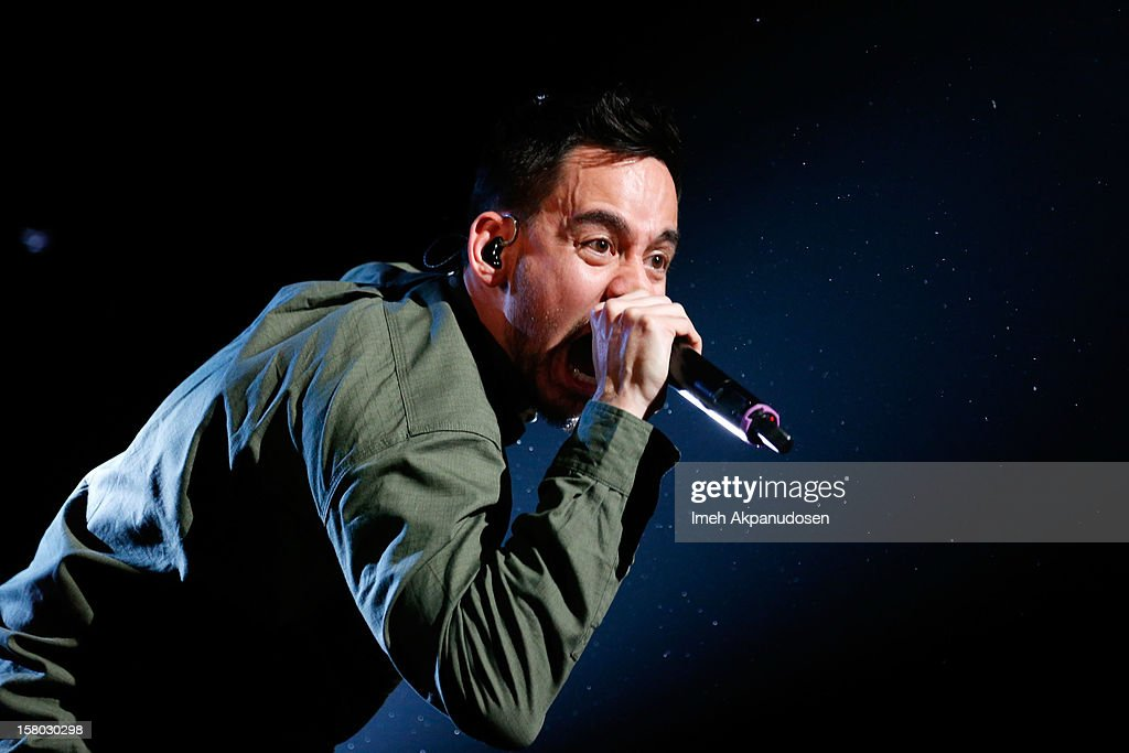 Musician <a gi-track='captionPersonalityLinkClicked' href=/galleries/search?phrase=Mike+Shinoda&family=editorial&specificpeople=657527 ng-click='$event.stopPropagation()'>Mike Shinoda</a> of Linkin Park performs at the 23rd Annual KROQ Almost Acoustic Christmas at Gibson Amphitheatre on December 8, 2012 in Universal City, California.