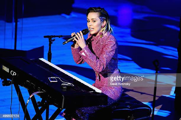 Musician Miley Cyrus performs on stage at the ONE Campaign and 's concert to mark World AIDS Day celebrate the incredible progress that's been made...