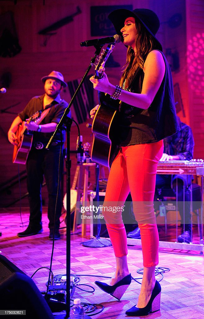 Musician Misael Arriaga (L) and singer/songwriter Kacey Musgraves perform at Gilley's Saloon, Dance Hall & Bar-B-Que at the Treasure Island Hotel & Casino as she tours in support of the album 'Same Trailer Different Park' on July 29, 2013 in Las Vegas, Nevada.