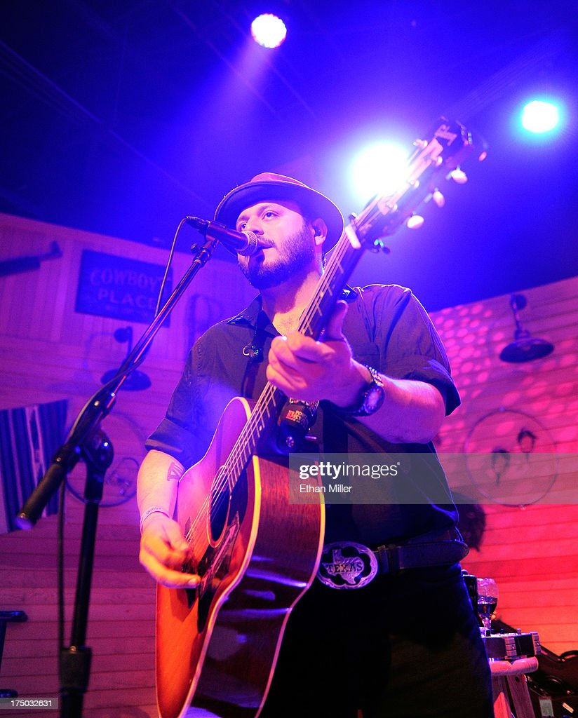 Musician Misael Arriaga performs with singer/songwriter Kacey Musgraves at Gilley's Saloon, Dance Hall & Bar-B-Que at the Treasure Island Hotel & Casino as she tours in support of the album 'Same Trailer Different Park' on July 29, 2013 in Las Vegas, Nevada.