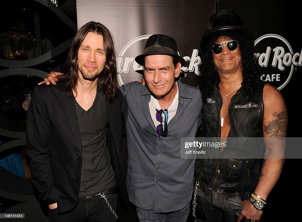 Musician Myles Kennedy actor Charlie Sheen and musician Slash pose after their performance at the Hard Rock Cafe on July 10 2012 in Hollywood...