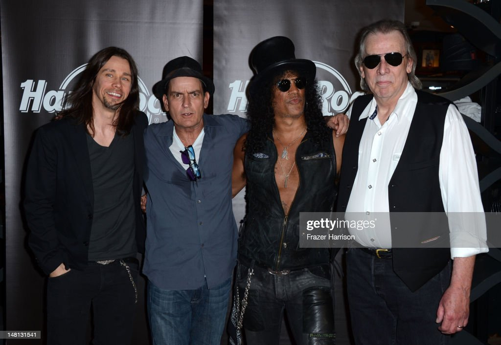 Musician Myles Kennedy actor Charlie Sheen Slash and DJ Jim Ladd at the Hard Rock Cafe after Slash was honored with the 2473rd Star on the Hollywood...