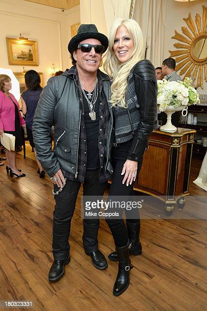 Musician Neal Schon and fiancé Michaele Salahi attend the MercedesBenz Star Lounge during MercedesBenz Fashion Week Spring 2014 on September 11 2013...
