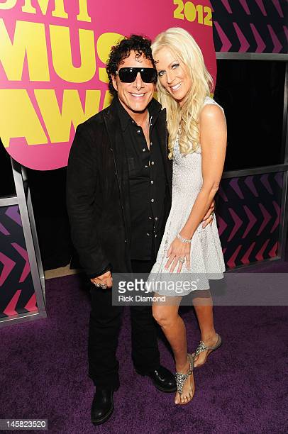 Musician Neal Schon and Michaele Salahi arrive at the 2012 CMT Music awards at the Bridgestone Arena on June 6 2012 in Nashville Tennessee