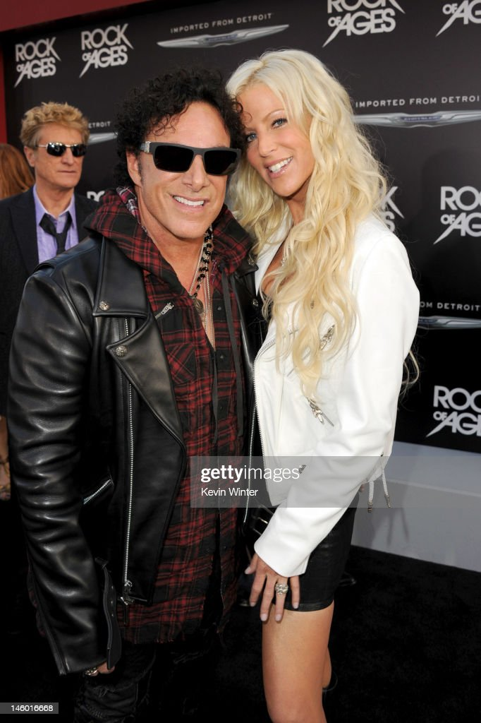 Musician <a gi-track='captionPersonalityLinkClicked' href=/galleries/search?phrase=Neal+Schon&family=editorial&specificpeople=595042 ng-click='$event.stopPropagation()'>Neal Schon</a> and Michaele Salahi arrive at the premiere of Warner Bros. Pictures' 'Rock of Ages' at Grauman's Chinese Theatre on June 8, 2012 in Hollywood, California.