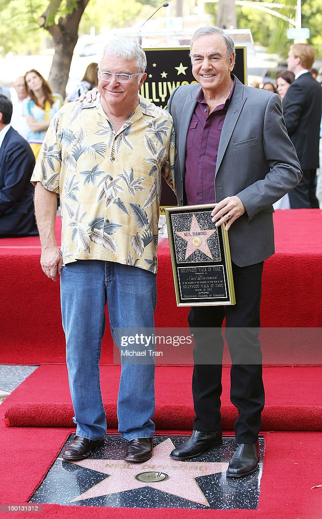 Musician <a gi-track='captionPersonalityLinkClicked' href=/galleries/search?phrase=Neil+Diamond&family=editorial&specificpeople=210635 ng-click='$event.stopPropagation()'>Neil Diamond</a> and composer <a gi-track='captionPersonalityLinkClicked' href=/galleries/search?phrase=Randy+Newman&family=editorial&specificpeople=194998 ng-click='$event.stopPropagation()'>Randy Newman</a> attend the ceremony honoring musician <a gi-track='captionPersonalityLinkClicked' href=/galleries/search?phrase=Neil+Diamond&family=editorial&specificpeople=210635 ng-click='$event.stopPropagation()'>Neil Diamond</a> with a Star on The Hollywood Walk of Fame held in front of the famed Capitol Records building on August 10, 2012 in Los Angeles, California.