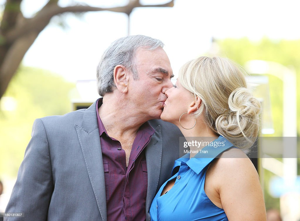 Musician <a gi-track='captionPersonalityLinkClicked' href=/galleries/search?phrase=Neil+Diamond&family=editorial&specificpeople=210635 ng-click='$event.stopPropagation()'>Neil Diamond</a> (L) and wife, Katie McNeil attend the ceremony honoring him with a Star on The Hollywood Walk of Fame held in front of the famed Capitol Records building on August 10, 2012 in Los Angeles, California.
