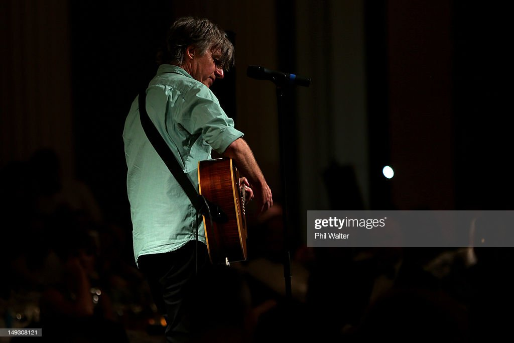 Musician <a gi-track='captionPersonalityLinkClicked' href=/galleries/search?phrase=Neil+Finn&family=editorial&specificpeople=209271 ng-click='$event.stopPropagation()'>Neil Finn</a> performs during the NZOC Governor General's Gala Dinner ahead of the London 2012 Olympic Games at Banqueting House, Whitehall on July 26, 2012 in London, England.