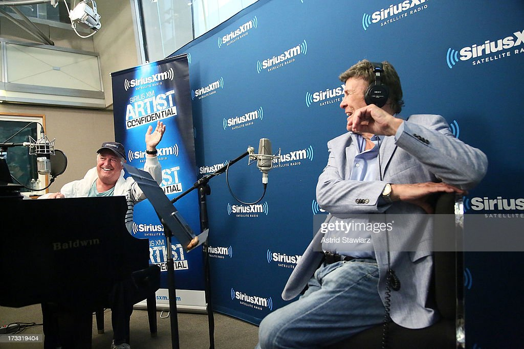 Musician Neil Sedaka performs at 'SiriusXM's 'Artist Confidential' hosted by Cousin Brucie (right) at SiriusXM Studios on July 11, 2013 in New York City.