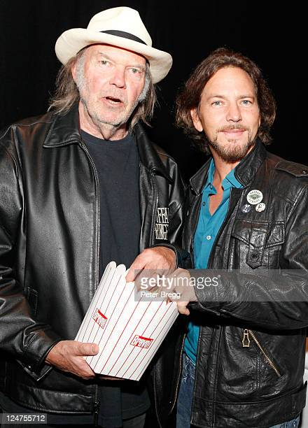 Musician Neil Young and musician Eddie Vedder attend 'Neil Young Life' Premiere at Princess of Wales during the 2011 Toronto International Film...