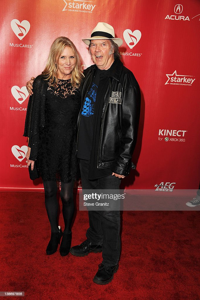 Musician Neil Young and wife Pegi Young arrive at The 2012 MusiCares Person of The Year Gala Honoring Paul McCartney at Los Angeles Convention Center on February 10, 2012 in Los Angeles, California.