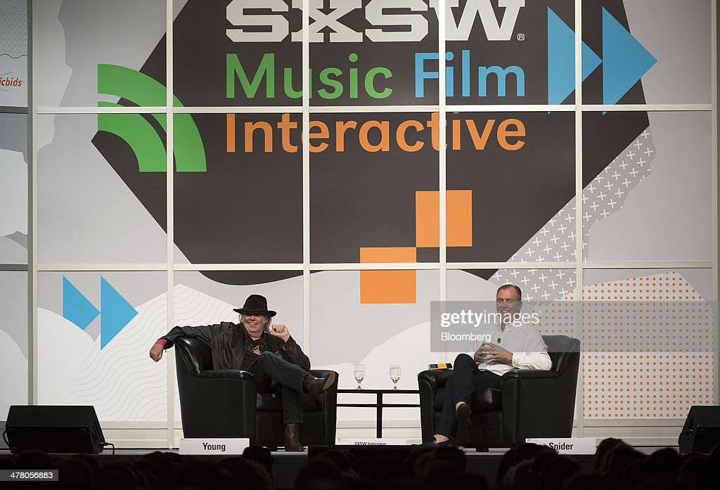 Musician Neil Young, founder and chairman of PonoMusic, left, and Jon Hamm, chief executive officer, listen to a question from the audience during a featured session at the South By Southwest (SXSW) Interactive Festival in Austin, Texas, U.S., on Tuesday, March 11, 2014. The SXSW conferences and festivals converge original music, independent films, and emerging technologies while fostering creative and professional growth. Photographer: David Paul Morris/Bloomberg via Getty Images