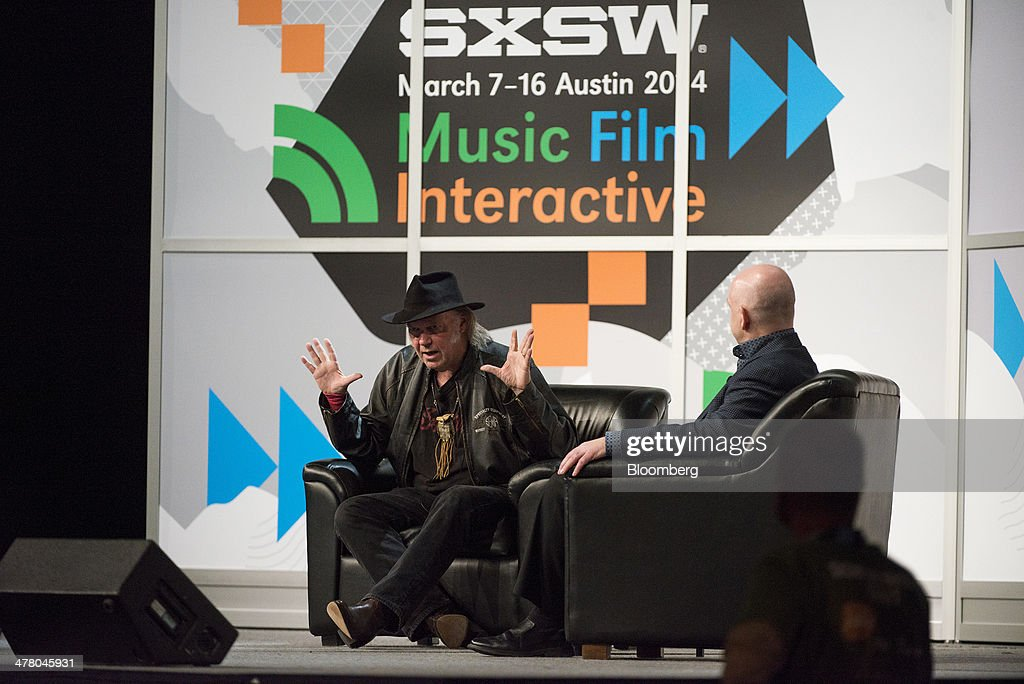 Musician <a gi-track='captionPersonalityLinkClicked' href=/galleries/search?phrase=Neil+Young&family=editorial&specificpeople=209195 ng-click='$event.stopPropagation()'>Neil Young</a>, founder and chairman of PonoMusic, left, speaks during a featured session at the South By Southwest (SXSW) Interactive Festival in Austin, Texas, U.S., on Tuesday, March 11, 2014. The SXSW conferences and festivals converge original music, independent films, and emerging technologies while fostering creative and professional growth. Photographer: David Paul Morris/Bloomberg via Getty Images