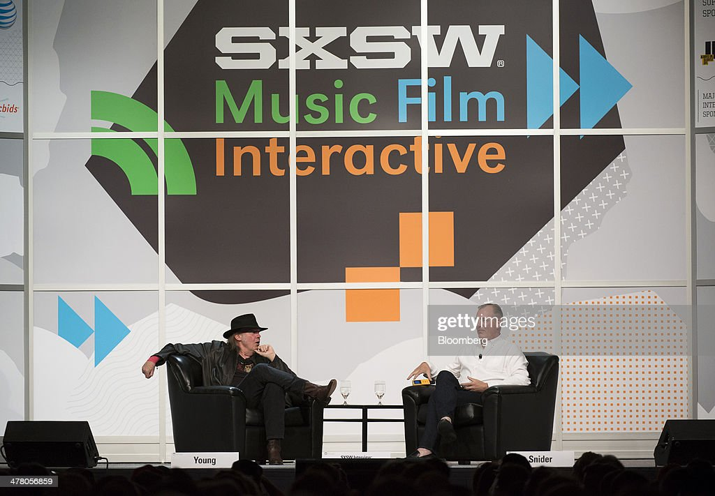 Musician Neil Young, founder and chairman of PonoMusic, left, speaks as Jon Hamm, chief executive officer, listens during a featured session at the South By Southwest (SXSW) Interactive Festival in Austin, Texas, U.S., on Tuesday, March 11, 2014. The SXSW conferences and festivals converge original music, independent films, and emerging technologies while fostering creative and professional growth. Photographer: David Paul Morris/Bloomberg via Getty Images