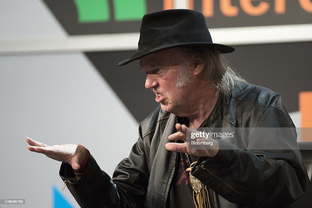 Musician <a gi-track='captionPersonalityLinkClicked' href=/galleries/search?phrase=Neil+Young&family=editorial&specificpeople=209195 ng-click='$event.stopPropagation()'>Neil Young</a>, founder and chairman of PonoMusic, speaks during a featured session at the South By Southwest (SXSW) Interactive Festival in Austin, Texas, U.S., on Tuesday, March 11, 2014. The SXSW conferences and festivals converge original music, independent films, and emerging technologies while fostering creative and professional growth. Photographer: David Paul Morris/Bloomberg via Getty Images