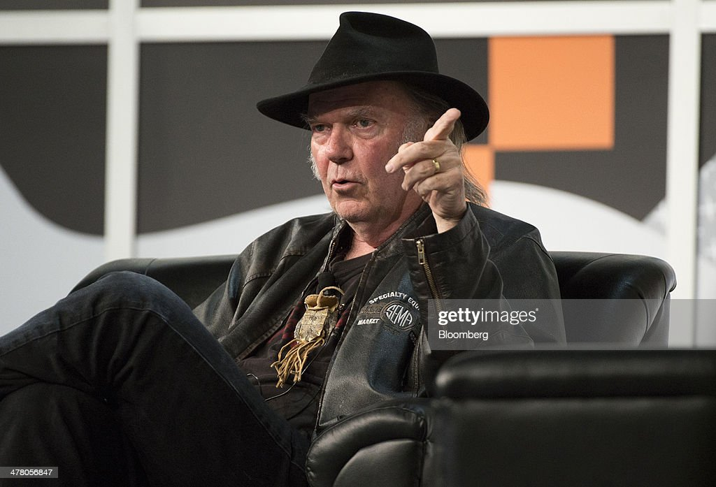 Musician Neil Young, founder and chairman of PonoMusic, speaks during a featured session at the South By Southwest (SXSW) Interactive Festival in Austin, Texas, U.S., on Tuesday, March 11, 2014. The SXSW conferences and festivals converge original music, independent films, and emerging technologies while fostering creative and professional growth. Photographer: David Paul Morris/Bloomberg via Getty Images
