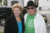 Musician Neil Young left and Senator Debbie Stabenow a Democrat from Michigan stand for a photograph at a news conference sponsored by the National...