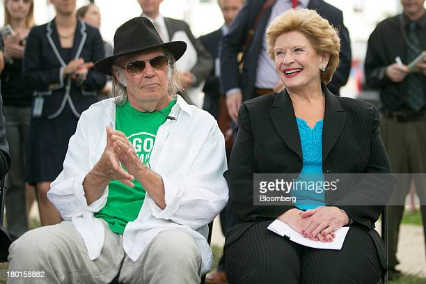Musician Neil Young left and Senator Debbie Stabenow a Democrat from Michigan attend a news conference sponsored by the National Farmers Union in...