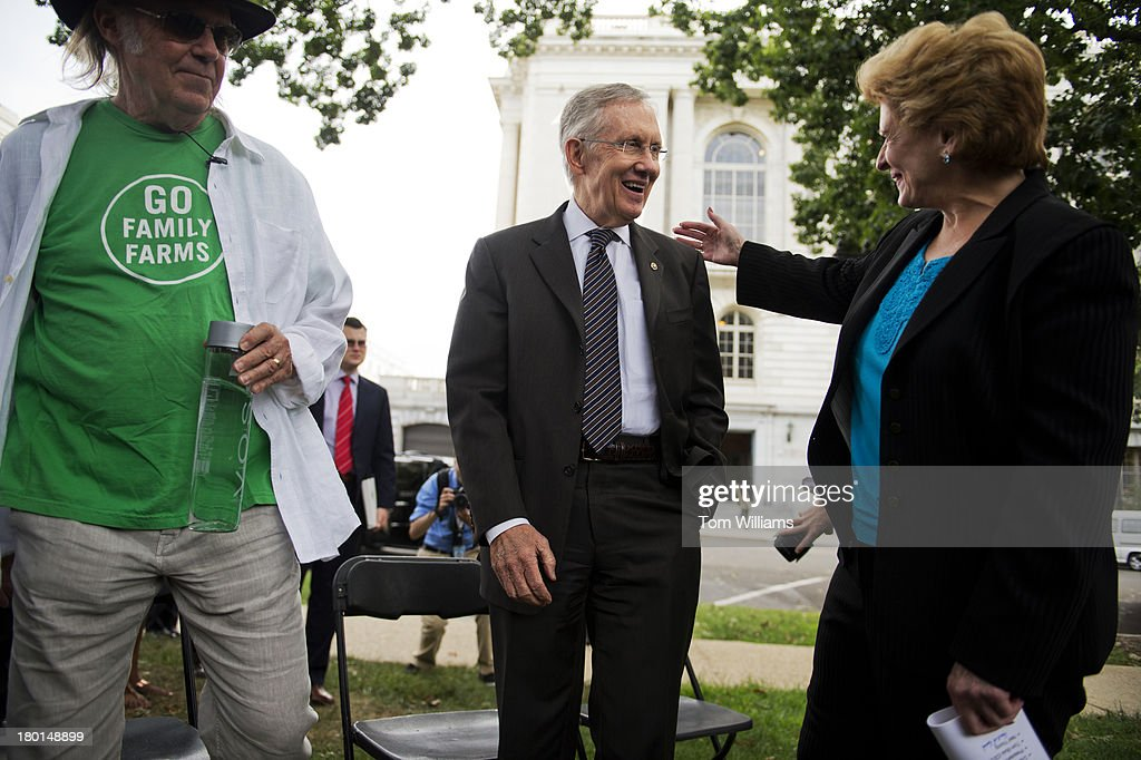 Musician Neil Young, left, Senate Majority Leader Harry Reid, D-Nev., and Sen. Debbie Stabenow, D-Mich., attend an event outside of Russell Building to highlight the importance of the Renewable Fuel Standard and passing a farm bill. The event was hosted by the National Farmers Union and Young was on hand because of his interest in fuel efficiency. Young owns a fuel efficient LincVolt car.