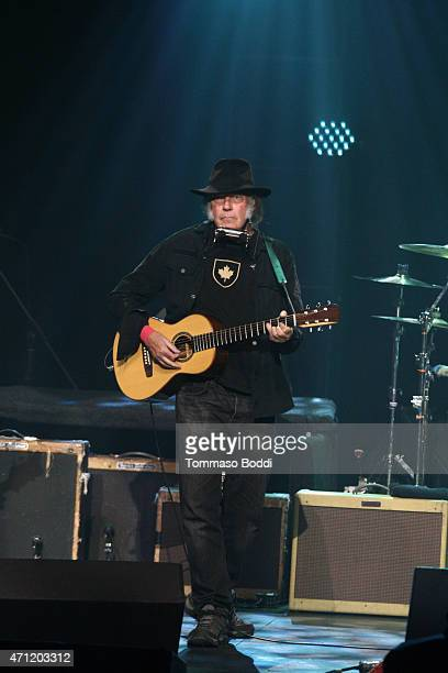 Musician Neil Young performs on stage during the 3rd Light Up the Blues Concert to benefit Autism Speaks held at the Pantages Theatre on April 25...