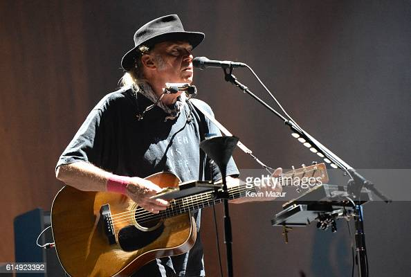 Musician Neil Young performs with Promise of the Real onstage during Desert Trip at The Empire Polo Club on October 15 2016 in Indio California