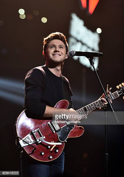 Musician Niall Horan performs onstage at Hot 995's Jingle Ball 2016 at Verizon Center on December 12 2016 in Washington DC