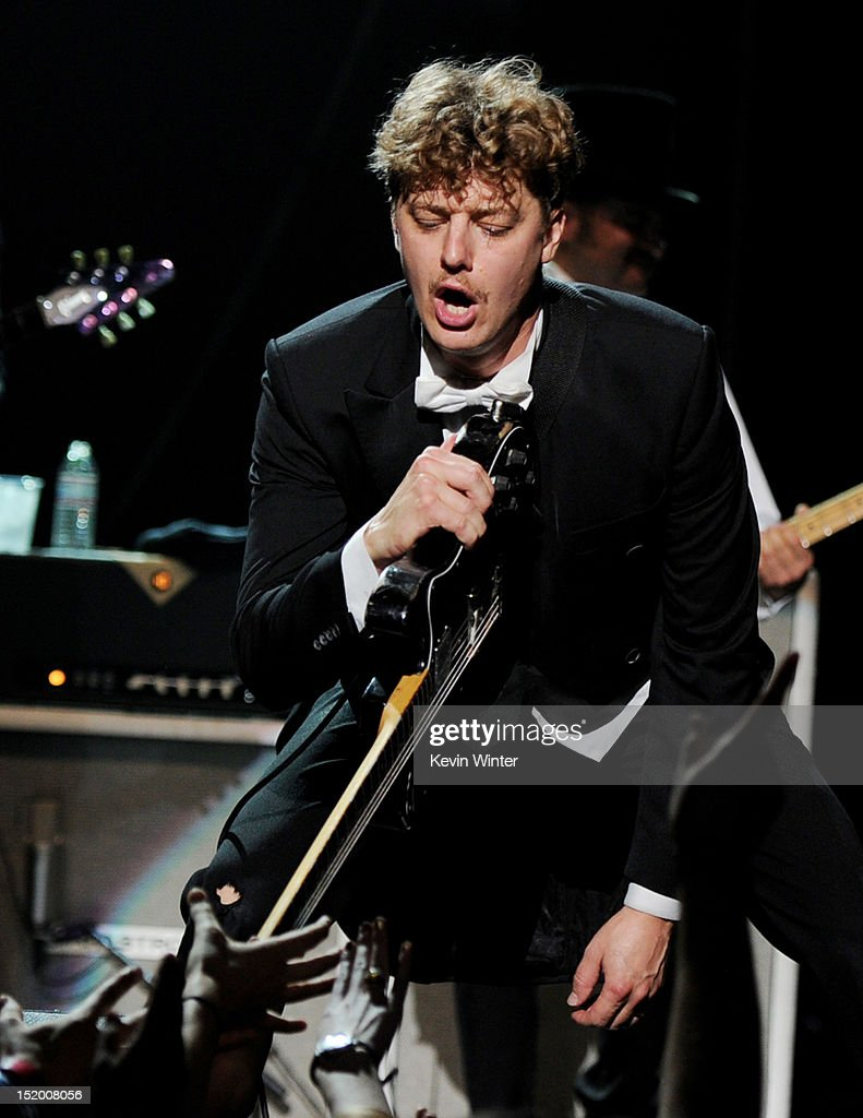 Musician <a gi-track='captionPersonalityLinkClicked' href=/galleries/search?phrase=Nicholaus+Arson&family=editorial&specificpeople=228515 ng-click='$event.stopPropagation()'>Nicholaus Arson</a> of The Hives performs at the Wiltern Theater on September 14, 2012 in Los Angeles, California.