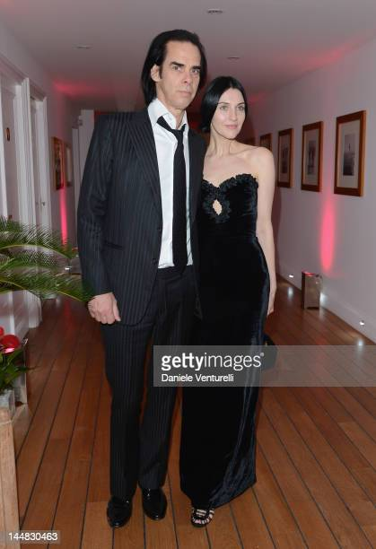 Musician Nick Cave and Susie Bick attend the Vanity Fair and Gucci Party at Hotel Du Cap during 65th Annual Cannes Film Festival on May 19 2012 in...
