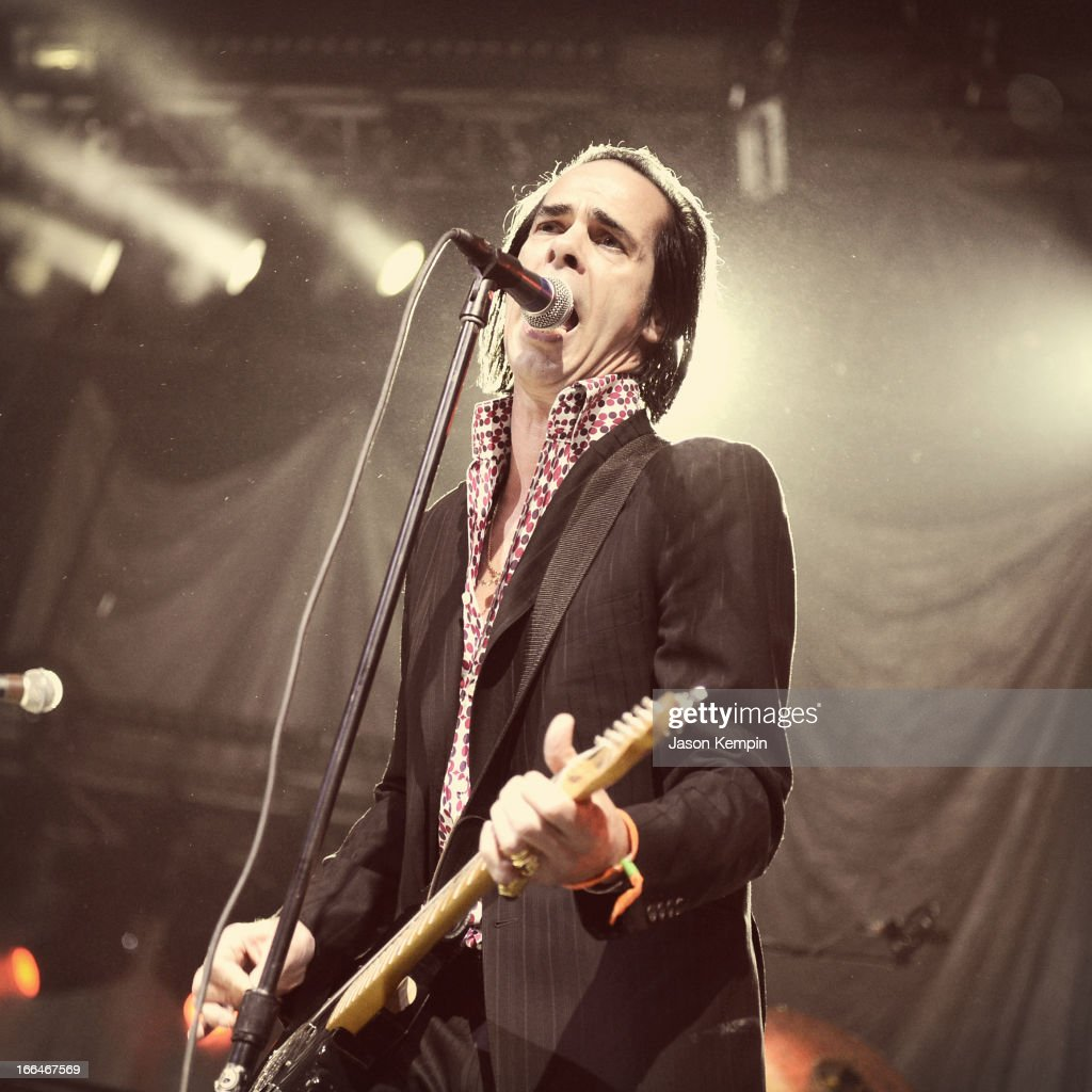 Musician <a gi-track='captionPersonalityLinkClicked' href=/galleries/search?phrase=Nick+Cave&family=editorial&specificpeople=212755 ng-click='$event.stopPropagation()'>Nick Cave</a> of Grinderman performs onstage during day 1 of the 2013 Coachella Valley Music & Arts Festival at the Empire Polo Club on April 12, 2013 in Indio, California.