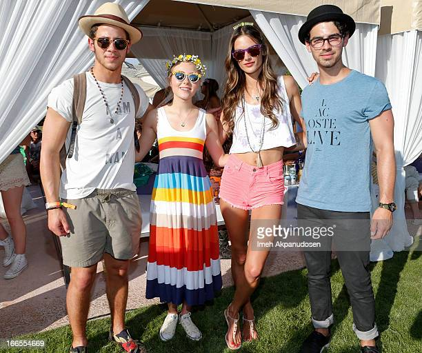 Musician Nick Jonas actress AnnaSophia Robb model Alessandra Ambrosio and musician Joe Jonas attend the FIJI Water At Lacoste LVE Coachella Desert...