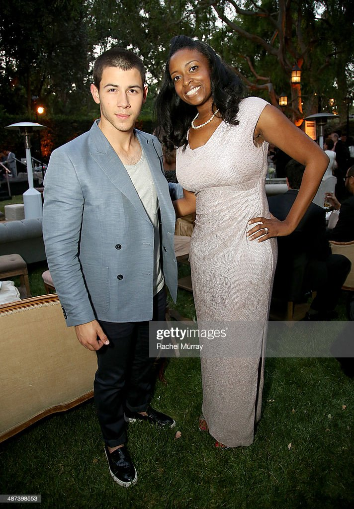 Musician Nick Jonas (L) and Honoree Dana Henry, Program Director of CISLA attend Communities In Schools Of Los Angeles Gala 2014, Presented By CAA And EIF on April 29, 2014 in Los Angeles, California.