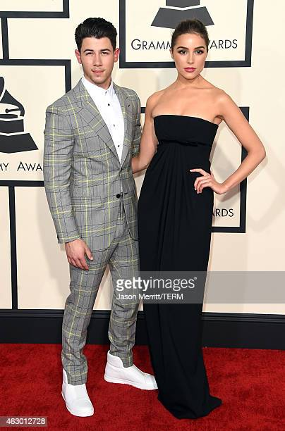 Musician Nick Jonas and model Olivia Culpo attend The 57th Annual GRAMMY Awards at the STAPLES Center on February 8 2015 in Los Angeles California
