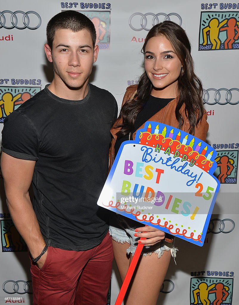 Musician Nick Jonas (L) and Olivia Culpo attends Audi Best Buddies' Bowling For Buddies at Lucky Strike Lanes at L.A. Live on April 27, 2014 in Los Angeles, California.