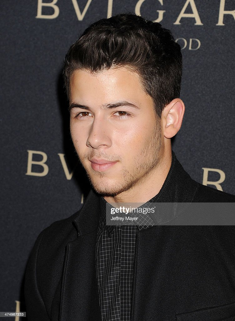 Musician Nick Jonas arrives at the BVLGARI 'Decades Of Glamour' Oscar Party Hosted By Naomi Watts at Soho House on February 25, 2014 in West Hollywood, California.