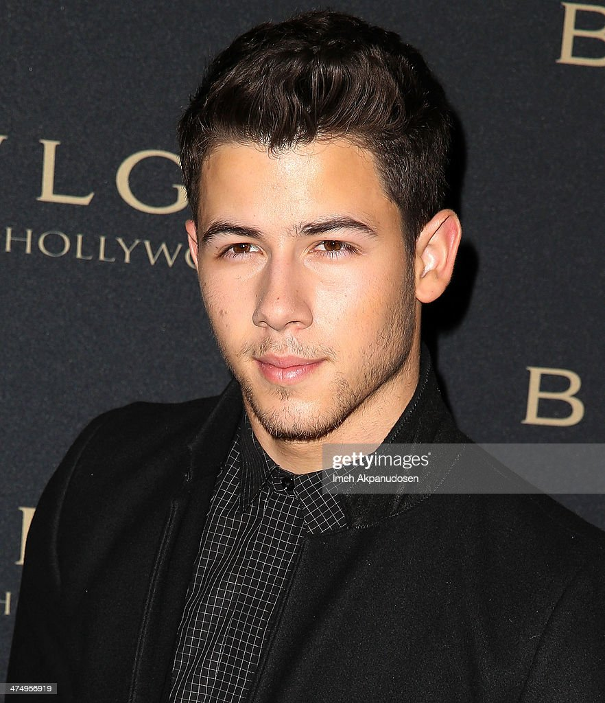 Musician <a gi-track='captionPersonalityLinkClicked' href=/galleries/search?phrase=Nick+Jonas&family=editorial&specificpeople=842713 ng-click='$event.stopPropagation()'>Nick Jonas</a> attends the BVLGARI 'Decades of Glamour' Oscar Party at Soho House on February 25, 2014 in West Hollywood, California.