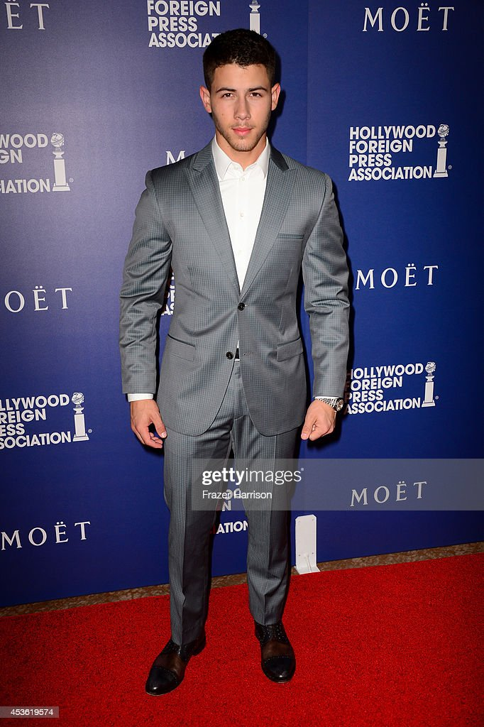 Musician <a gi-track='captionPersonalityLinkClicked' href=/galleries/search?phrase=Nick+Jonas&family=editorial&specificpeople=842713 ng-click='$event.stopPropagation()'>Nick Jonas</a> attends the Hollywood Foreign Press Association's Grants Banquet at The Beverly Hilton Hotel on August 14, 2014 in Beverly Hills, California.