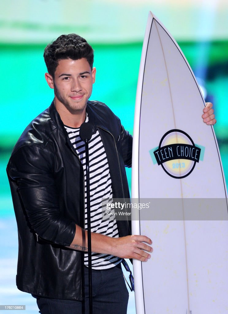 Musician <a gi-track='captionPersonalityLinkClicked' href=/galleries/search?phrase=Nick+Jonas&family=editorial&specificpeople=842713 ng-click='$event.stopPropagation()'>Nick Jonas</a> speaks onstage during the Teen Choice Awards 2013 at Gibson Amphitheatre on August 11, 2013 in Universal City, California.