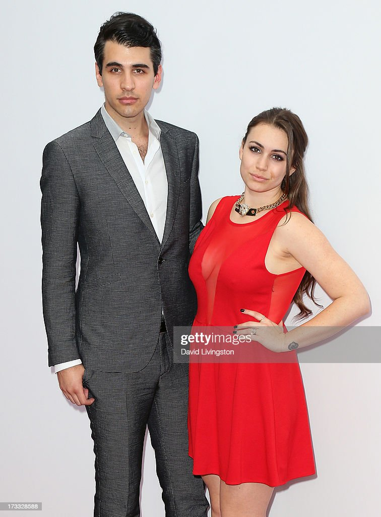 Musician Nick Simmons (L) and sister TV personality Sophie Simmons attend the premiere of Summit Entertainment's 'RED 2' at Westwood Village on July 11, 2013 in Los Angeles, California.