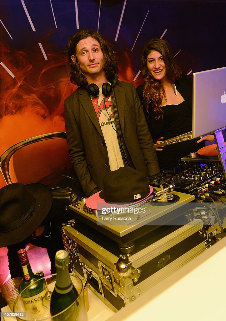 Musician <a gi-track='captionPersonalityLinkClicked' href=/galleries/search?phrase=Nick+Valensi&family=editorial&specificpeople=651473 ng-click='$event.stopPropagation()'>Nick Valensi</a> (L) of The Strokes DJs the Carrera Cocktail Party hosted by AD Oasis at The Raleigh on December 6, 2012 in Miami, Florida.